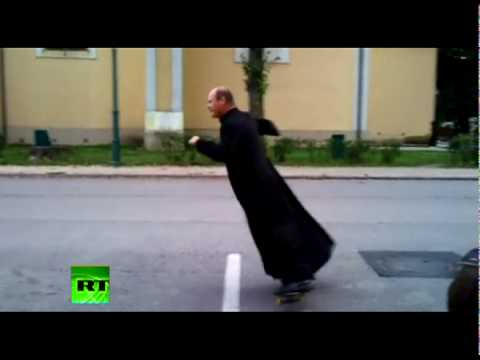 Skateboarding priest shows class in Hungary