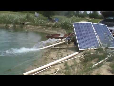 Fish pond stirring using a trash pump solar panels pumping pond