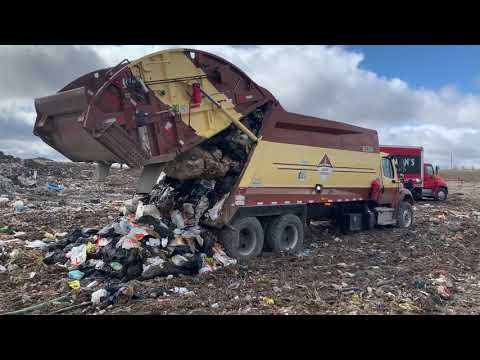 Unloading A Garbage Truck At The Dump
