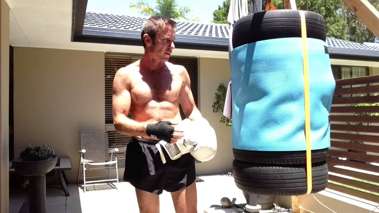 Tire Punching Bag Covered Over With Mat Youtube