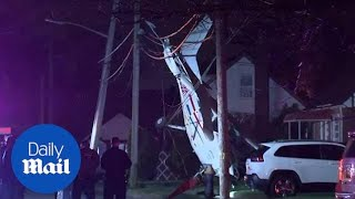 Small plane crashes onto front yard of Long Island home