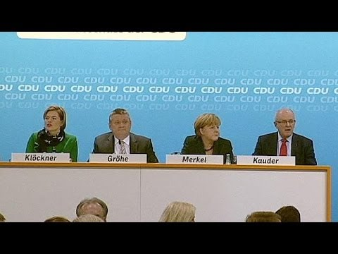 Merkel's CDU vote to back coalition deal with SPD despite misgivings