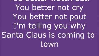 Lyrics on screen for Justin Bieber's song Santa Claus is coming to town You better watch out You better not cry Better not pout I'm telling you why Santa Claus is ...