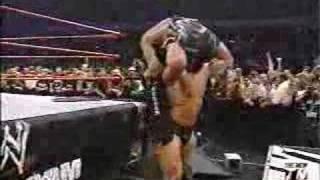 Brock Lesnar Powerbombs RVD Through A Table