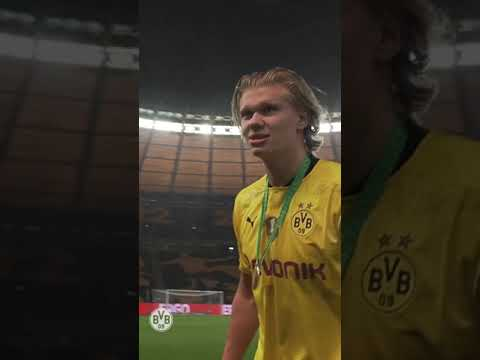Erling Haaland demands for champange after getting the DFB Pokal winners medal