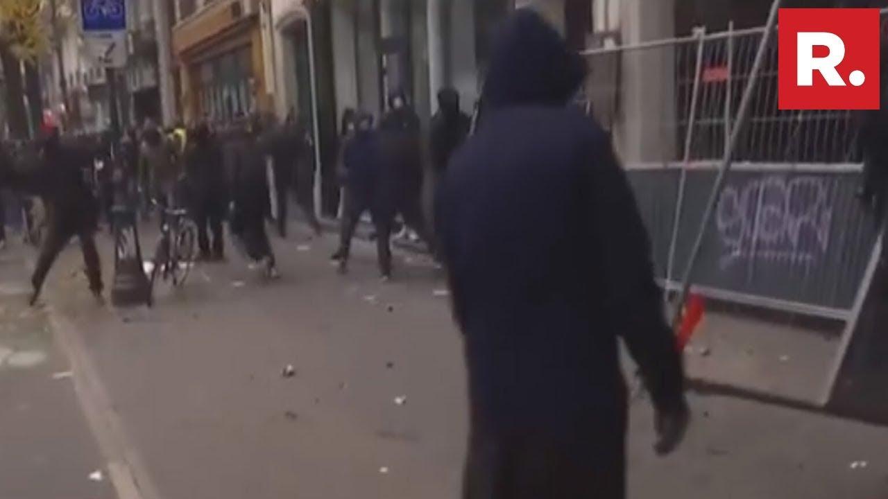 Massive Protest Erupts In Paris Against French President Emmanuel Macron's Pension Reform Plans