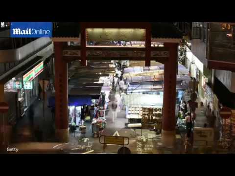 Elevated timelapse views show people shopping in Hong Kong