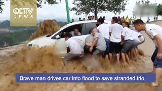 Brave driver enters flood to save stranded trio