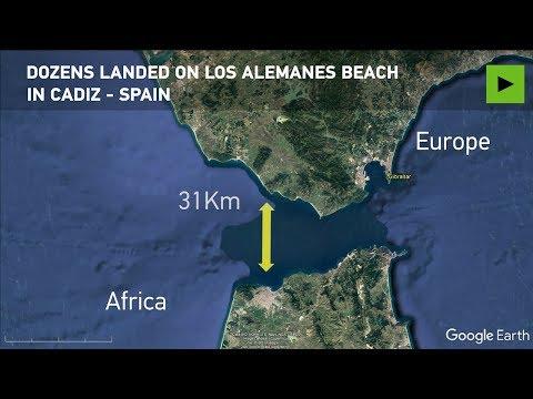 Sunbathers stunned by migrants landing on Spanish beach