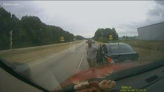 Dashcam video: Man dragged by car down road in a headlock