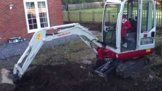 Young digger driver on a Takeuchi TB016 Mini Excavator