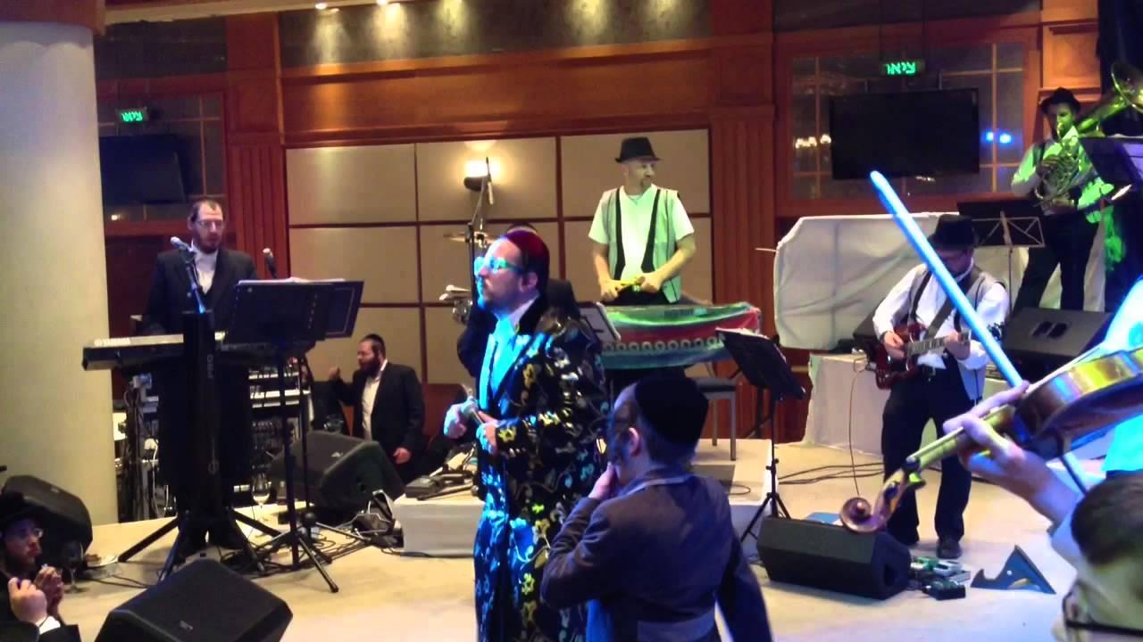 Lipa Schmeltzer and David Taub rocking a wedding with Ruvi Banet Orchestra
