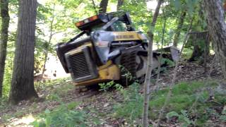 New Holland Track Loader turning path into road