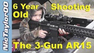 child shooting the 3 gun ar15 at 100 yard steel targets
