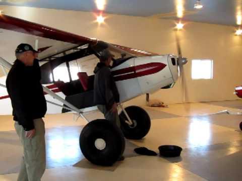Swing starting a Piper Cub PA11.MOV