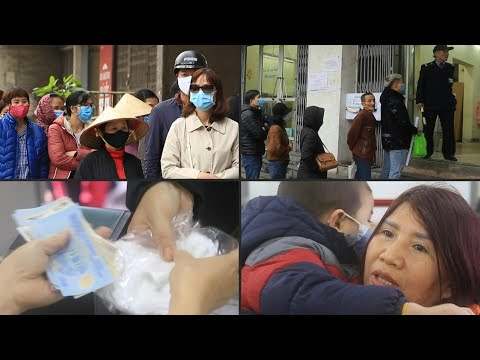 Vietnamese line up to buy face masks amid virus concern | AFP