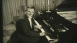 Liberace playing Canadian Capers in 1954