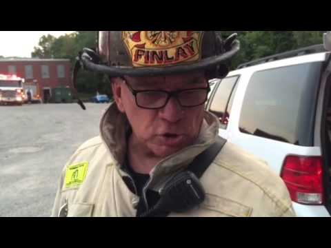 Cumberland Fire Chief Ken Finlay shows batteries that ignited in Cadillac  Mills complex in Cumberlan