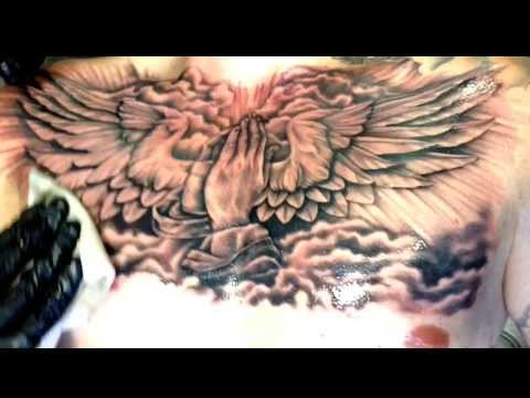 Religious praying hands chest piece tattooed by lou bragg for Chest mural tattoos