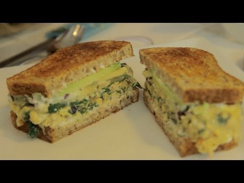 Open-Faced Broiled Egg, Green spinach, and Tomato Sandwich