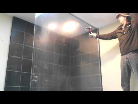 Breaking tempered glass shower wall door.