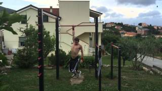 weighted one arm dead hang 52 kg 115 lbs