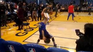 Stephen Curry with Noah Cutler dribbling pregame