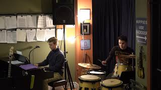 Zach Performing Four On Six Main Street Music and Art Studio