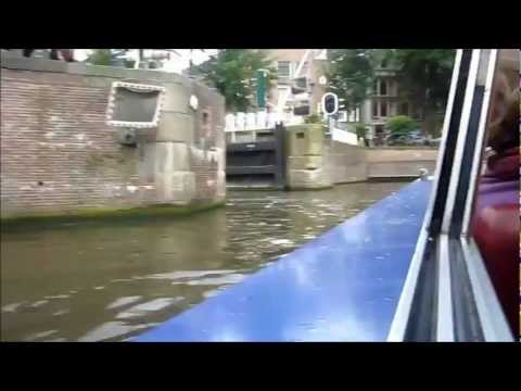 Canal boat in Amsterdam Holland makes a crazy 90 degree turn