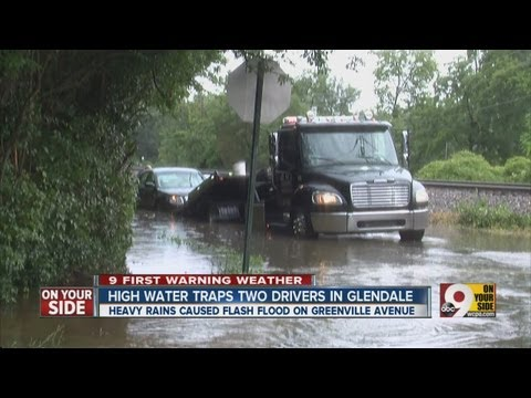 Two drivers trapped in Glendale after car is submerged by flood waters