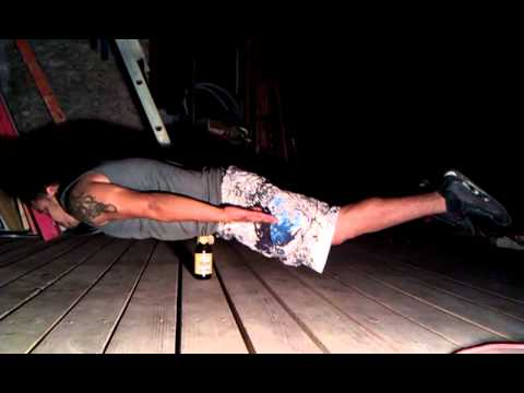 Planking on a beer bottle