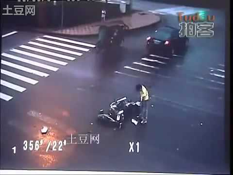 Biker Crashes Into A Truck, Flips Over & Lands On His Feet!