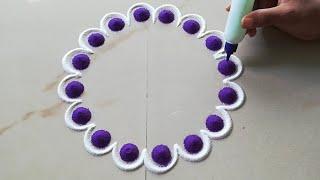 Simple rangoli design by Sangeeta