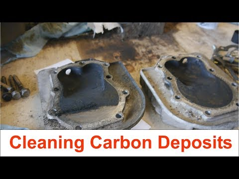 Cleaning carbon deposits on Briggs and Stratton twin cylinder heads and pistons