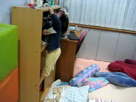13 Month Old Jane Climbing A Book Shelf