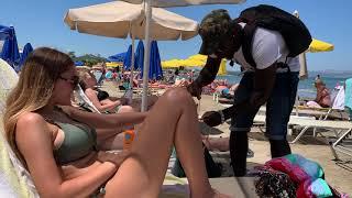 Happy Salesman on Agia Marina Beach, CRETE - July 2019