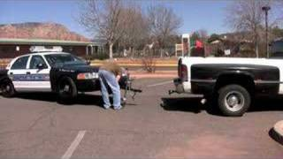 Decoy police car teardown and tow away...ONE guy!