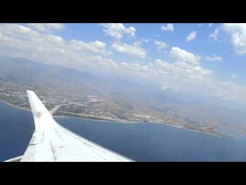 Airplane takeoff from Dili, Timor Leste and landing in Bali, Indonesia
