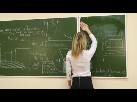 Female Teacher Rubbing Off a Blackboard   Stock Footage