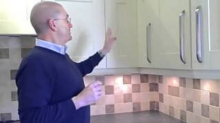 Watch our guide on how to replace the doors on an L-shaped corner cupboard. Browse our range of kitchen doors: http://www.