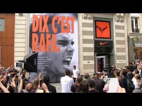 Rafael Nadal greets fans at Nike store after his 10th victory at Tennis French Open