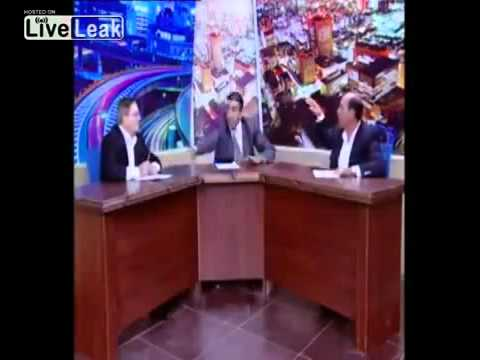 Funny arab live tv fight pulls gun!
