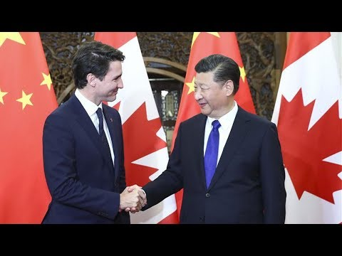 Chinese President Xi Jinping meets Canadian PM Justin Trudeau in Beijing