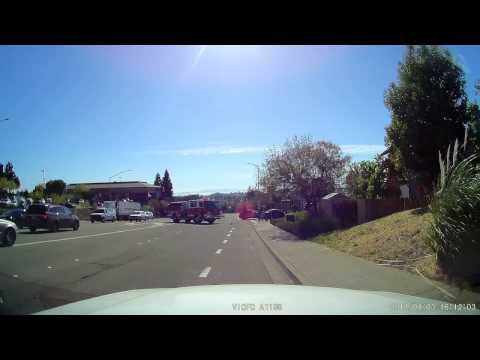 Motorist pulls in front of fire truck and gets side swiped