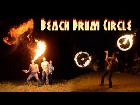 Download lagu Mp3 Beach Drum Circle - Fire dancers light up a beach on the Mississippi River in Rock Island, IL terbaru 2020