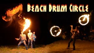 Beach Drum Circle - Fire dancers light up a beach on the Mississippi River in Rock Island, IL