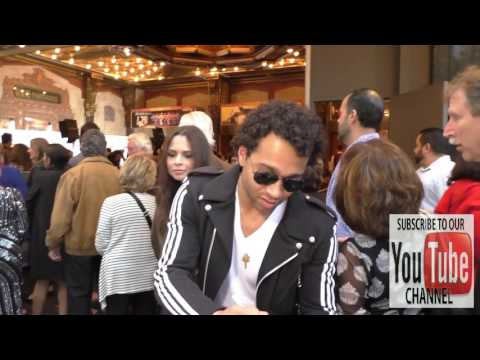 Corbin Bleu and Sasha Clements greet  outside Pantages Theatre in Hollywood