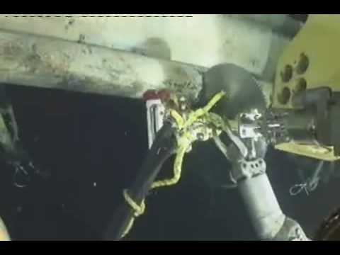 extracting stuck cutting wheel Gulf Mexico 2010 BP Oceaneering ROV cam