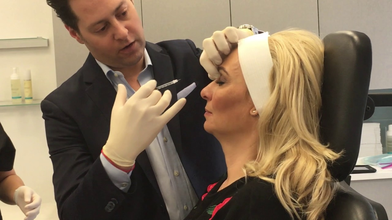 Dr Eric Schweiger Performing Botox Injections On Mary Sciarrone Of Cake Boss