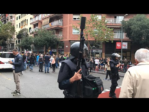LIVE NOW: Police in #Barcelona blocking the vote #CatalanReferendum